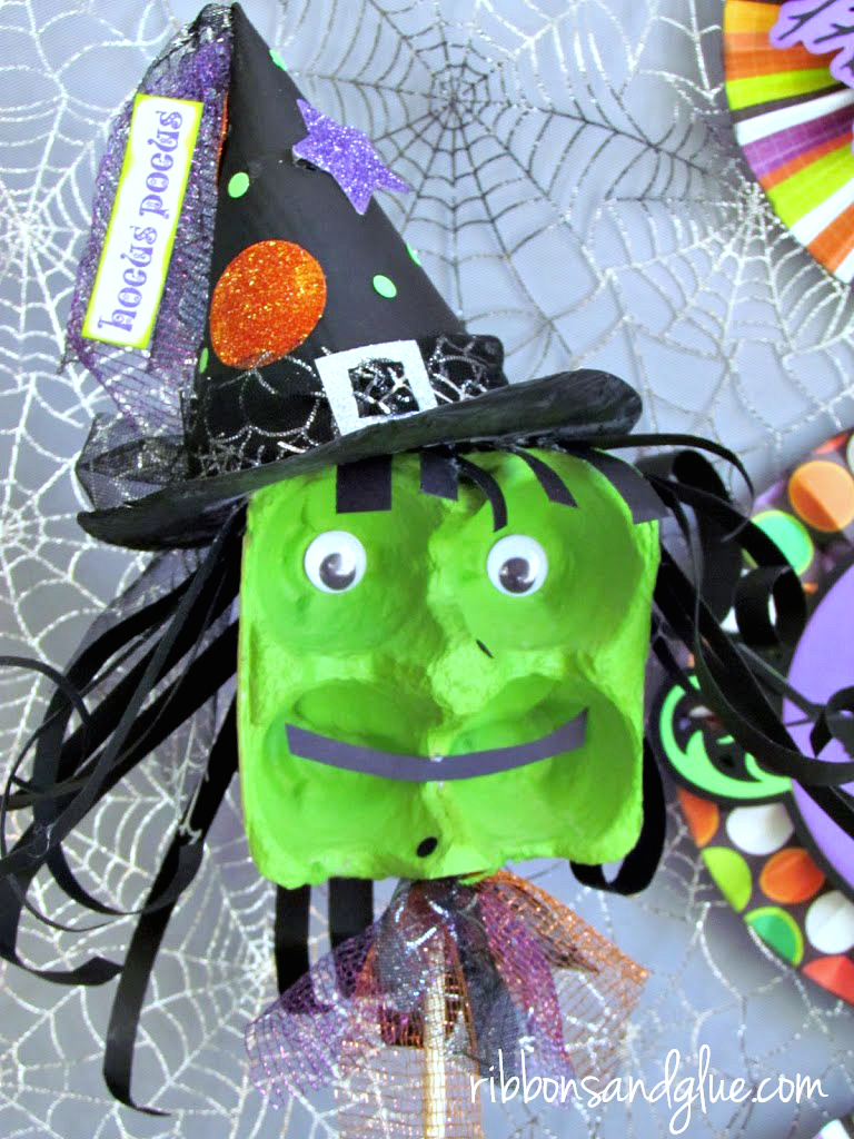 Egg Carton Halloween Witch made out of a painted cardboard egg carton. Fun classroom or Halloween party activity for the kids.