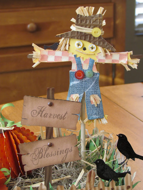 Fall Scarecrow and Pumpkin Centerpiece made from die cut and 3D Paper pumpkins makes for a unique Fall Centerpiece idea.