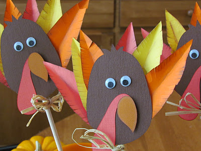 Turkey Table Decorations for the little table made with Circut. Love the google eyes and raffia!