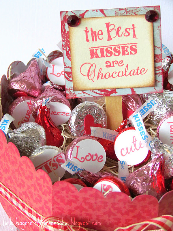 Stamped Chocolate Kisses in a paper bowl! Use a 3/4 circle punch to punch the circles then stamp Valentine's sentiments on each one and adhere in to Chocolate Kiss. Easy Valentine's Day craft!