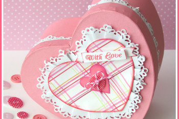 Paper mache heart box altered with paper lace