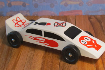 Pinewood Derby Car embellished with vinyl decals cut with Cricut. Area 51 theme