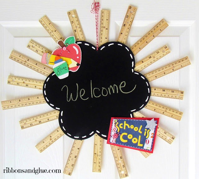 DIY Back to School Ruler Wreath.  All you need to make this classroom decor is a chalkboard, hot glue, school themed die cuts and rulers.  Creative addition to any classroom