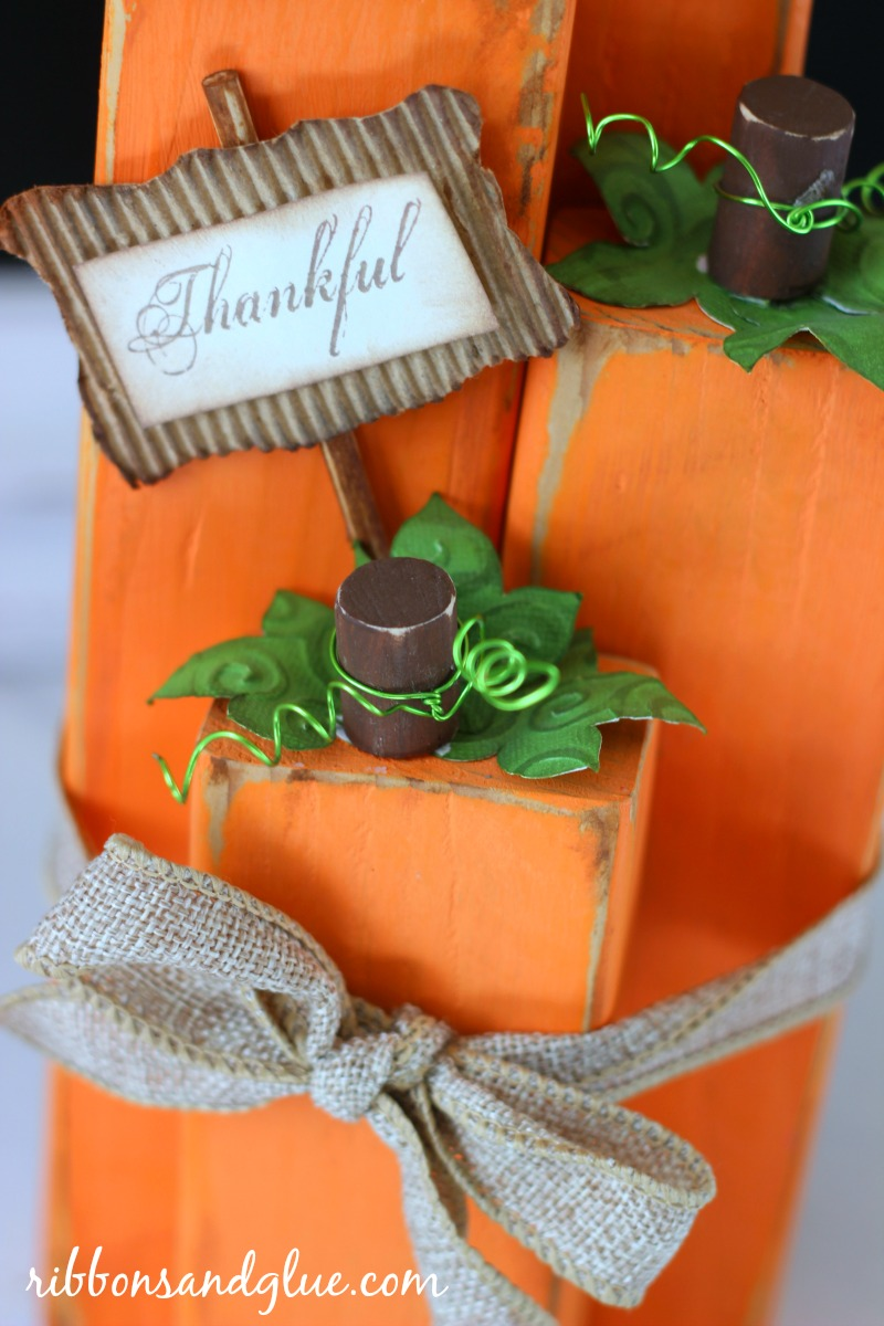 DIY Wood Block Pumpkins. Create this simple Fall centerpiece idea by making Wood Pumpkins out of various sizes of wood blocks.