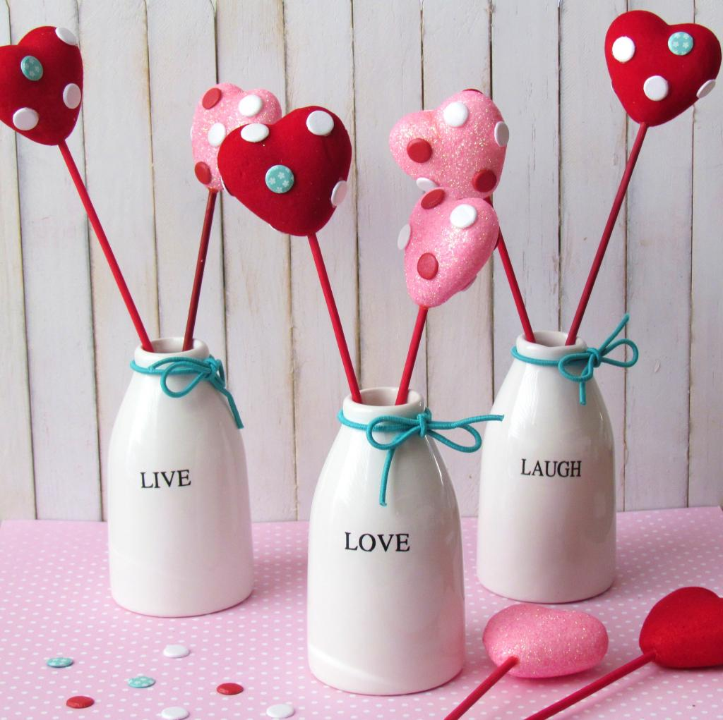 Valentine's Hearts on a stick. Dollar Store Hearts embellished with cute little dots and stuck in Dollar Store jars. Easy Valentine's Decoration!