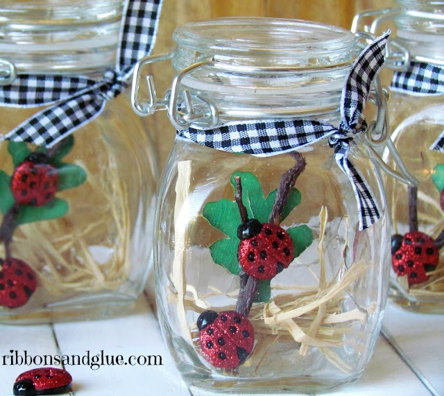 Lady Big Party Favors made with ladybug buttons and small glass jars
