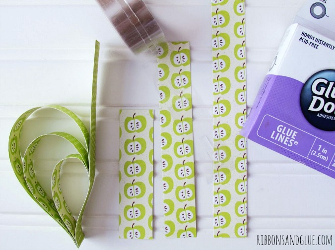 Paper Heart Garland Tutorial. Glue Paper strips together into a shape of heart. So easy!