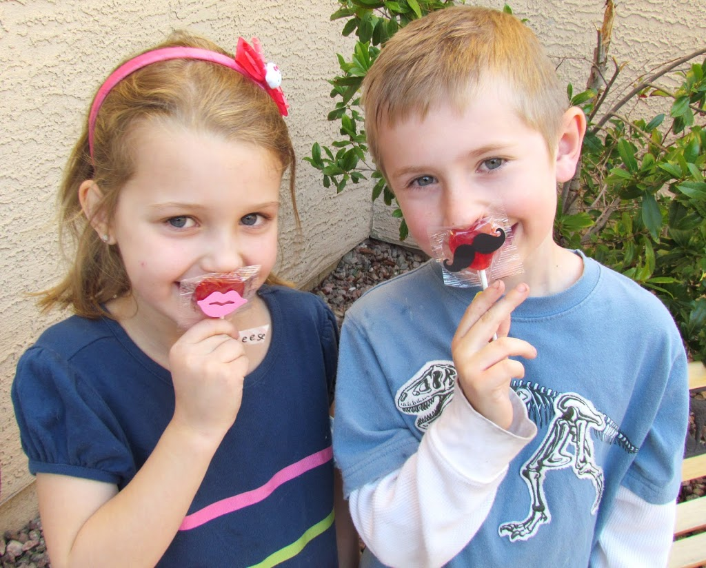 Mustaches and Lips Valentine's Lollipops. Just adhere die cut on to lollipops. Such and easy Valentine's craft the kids can make