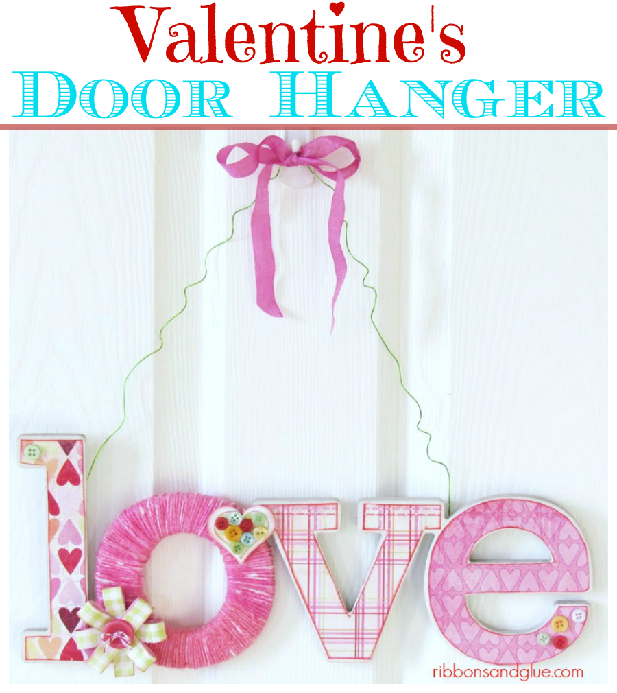 valentines love yarn door hanger made from decoupage chipboard letters wrapped in yarn