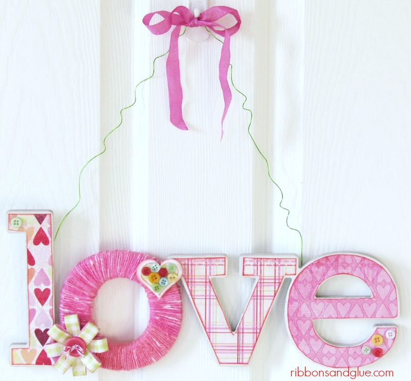 Valentine's Love Door Hanger. Chipboard love sign wrapped with yarn and decoupaged with Valentine's paper.