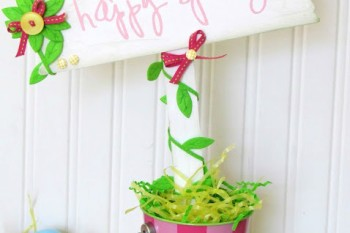 DIY Happy Spring Sign made out of a wood plaque and a paint sticks.