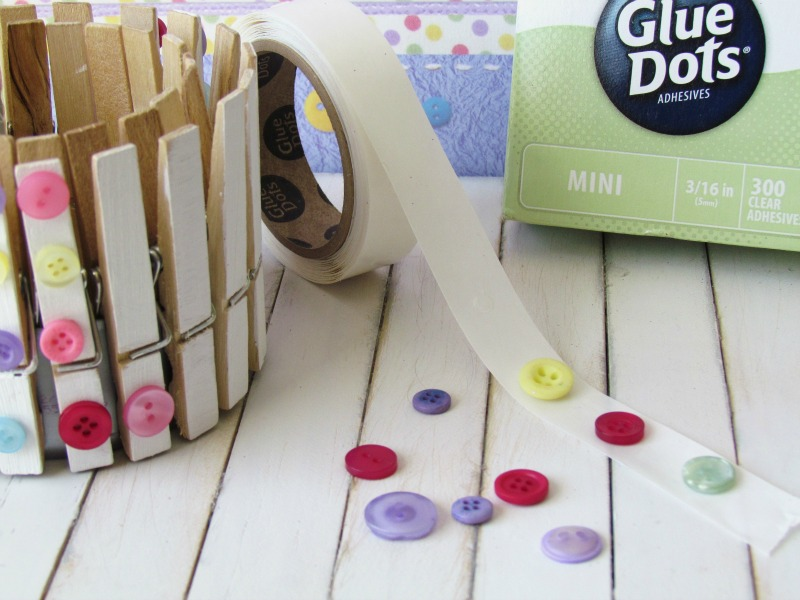 Adhere buttons on to clothespins with Glue Dots to make Clothespins Decor