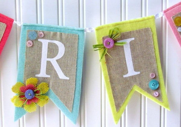 Pre-Made Burlap and felt banner embellished with burlap flowers and buttons . Easy makeover!
