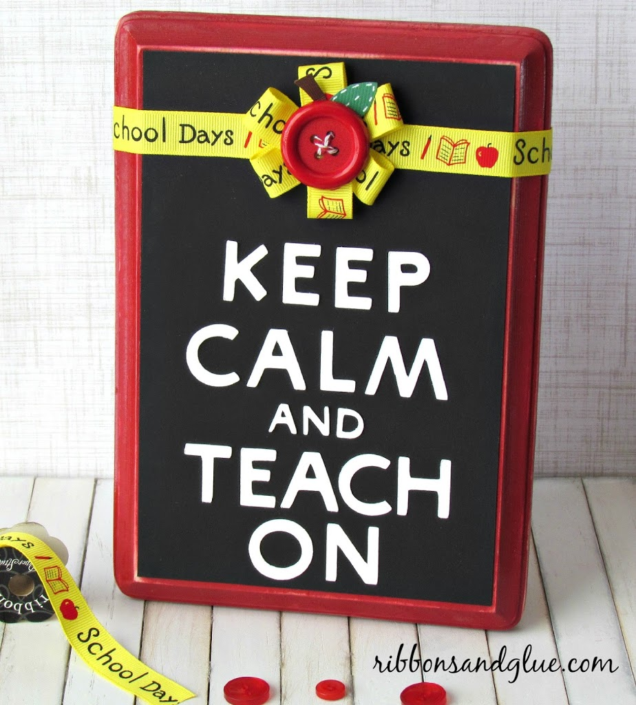 DIY Keep Calm and Teacher Plaque Idea. Unique Teacher Appreciation Gift Idea made from a painted wood plaque, die cut letters, ribbon and apple button