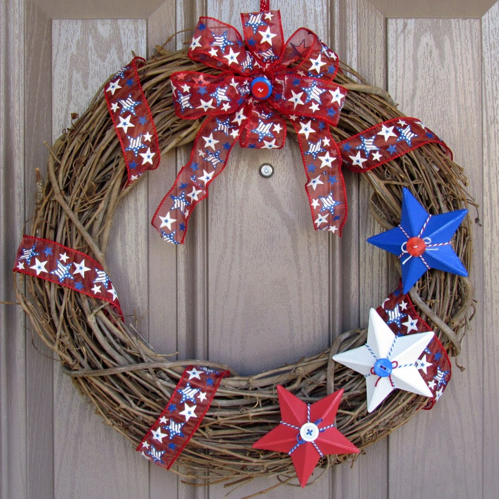 Red White and Blue Star Wreath made from painted paper mache stars and patriotic ribbon