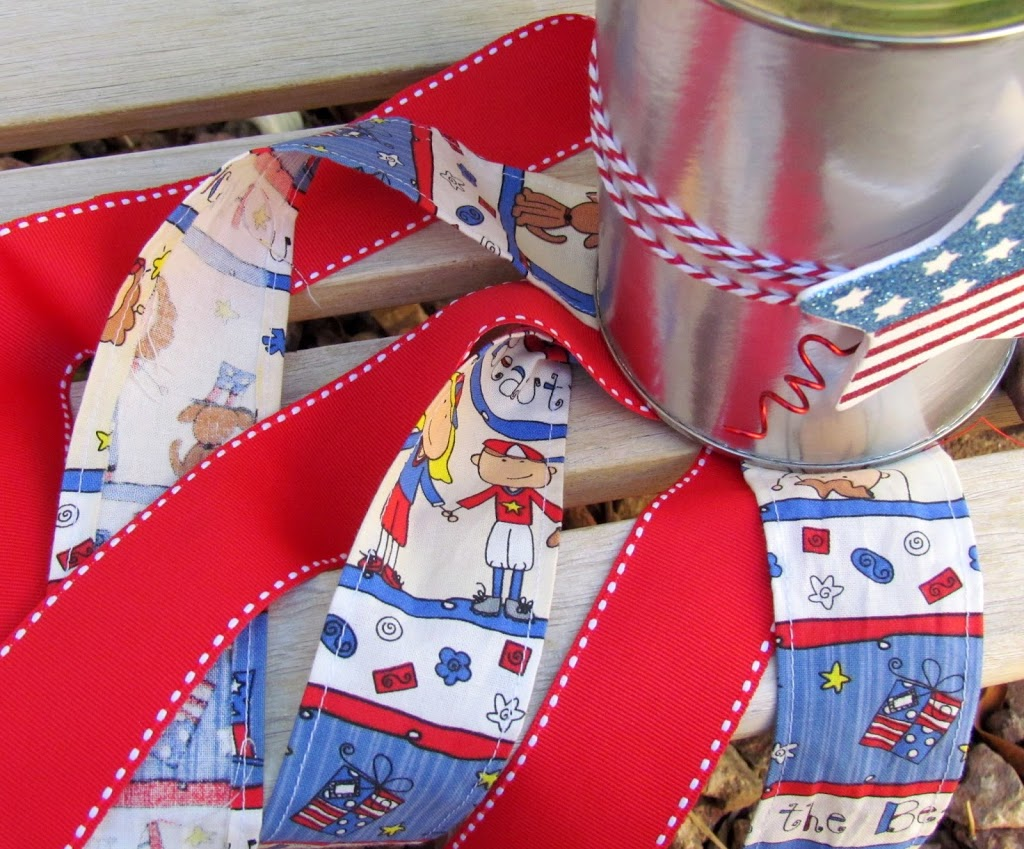 DIY Patriotic Windsock made out of a coffee can and scrap fabric. Easy Patriotic Craft project!