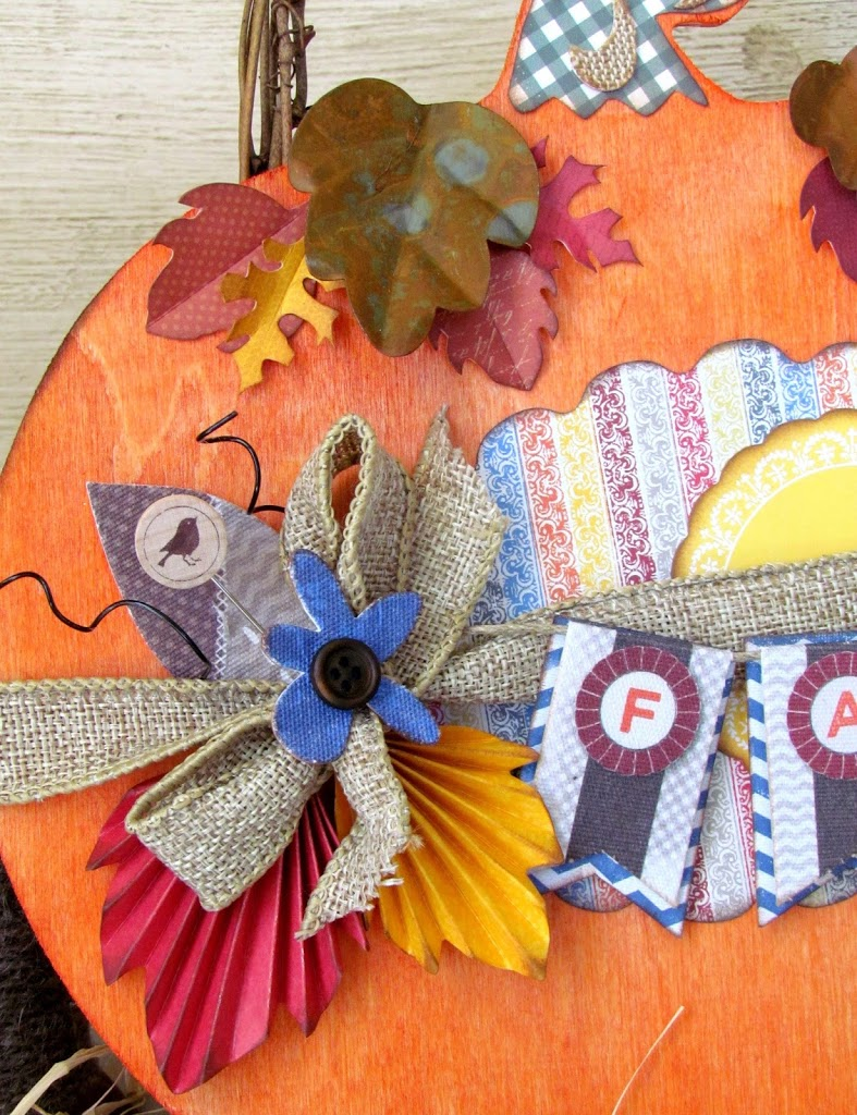 Fall Pumpkin Plaque craft dyed with Rit Dye and embellished with scrapbooking paper and embellishments