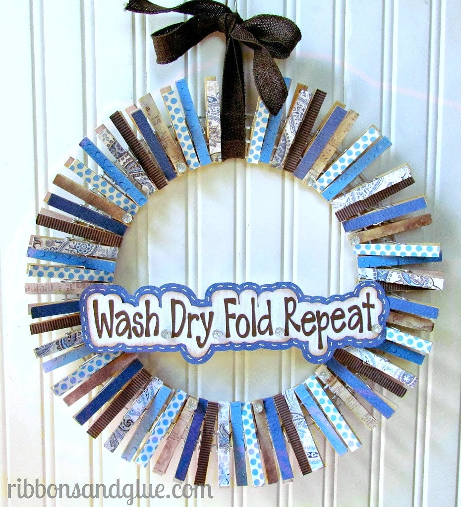 DIY Laundry Room Wreath made with scrapbookng paper and decoupaged clothespins. Easy and awesome!