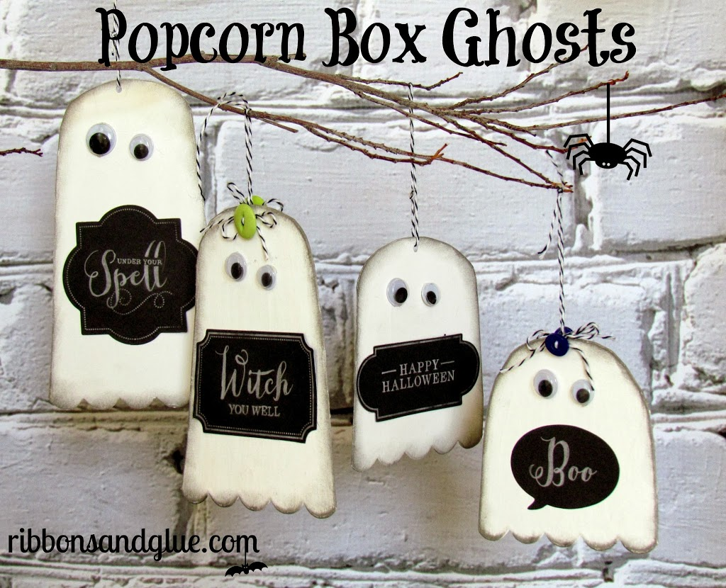 Popcorn Box Ghosts! Such an easy craft to make, by simply cutting ghost shapes out of popcorn boxes then paint them.