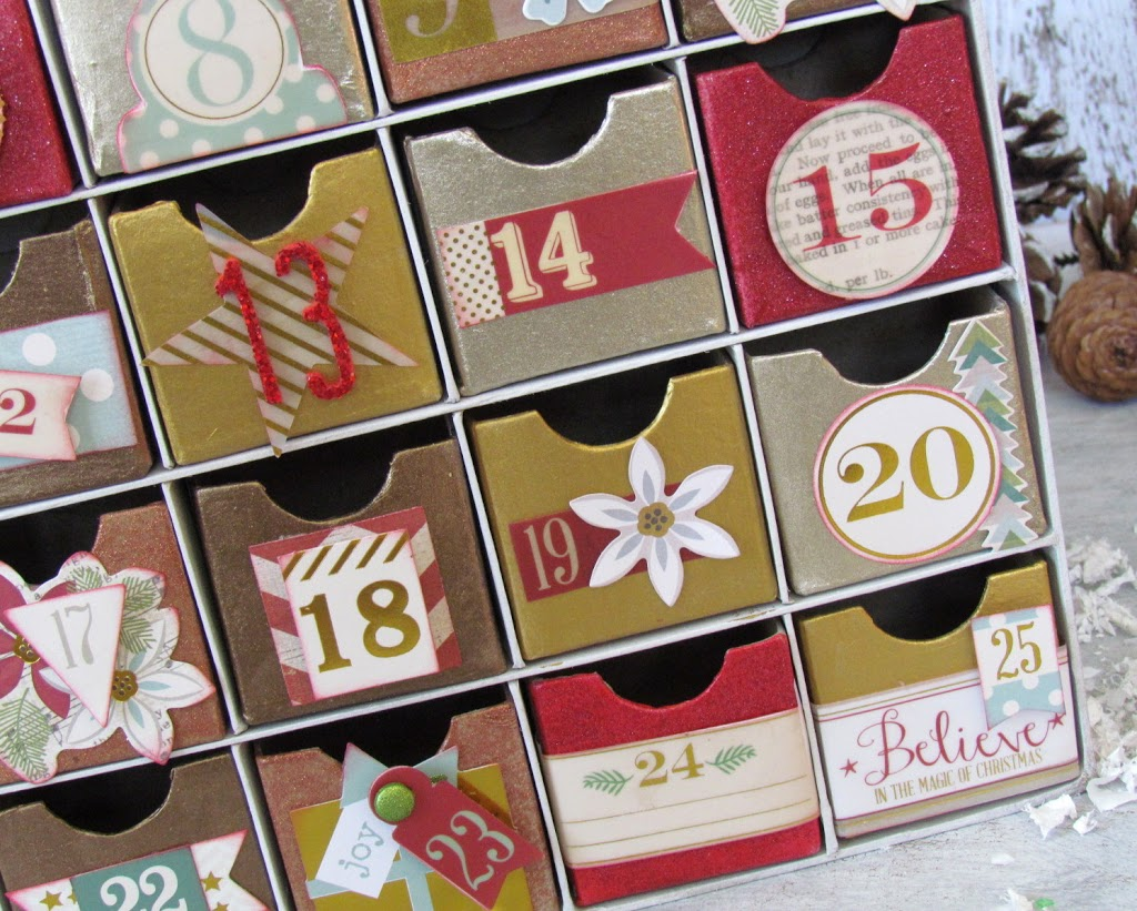 DIY Advent Calendar painted with metallic paints and embellished with scrapbooking paper.