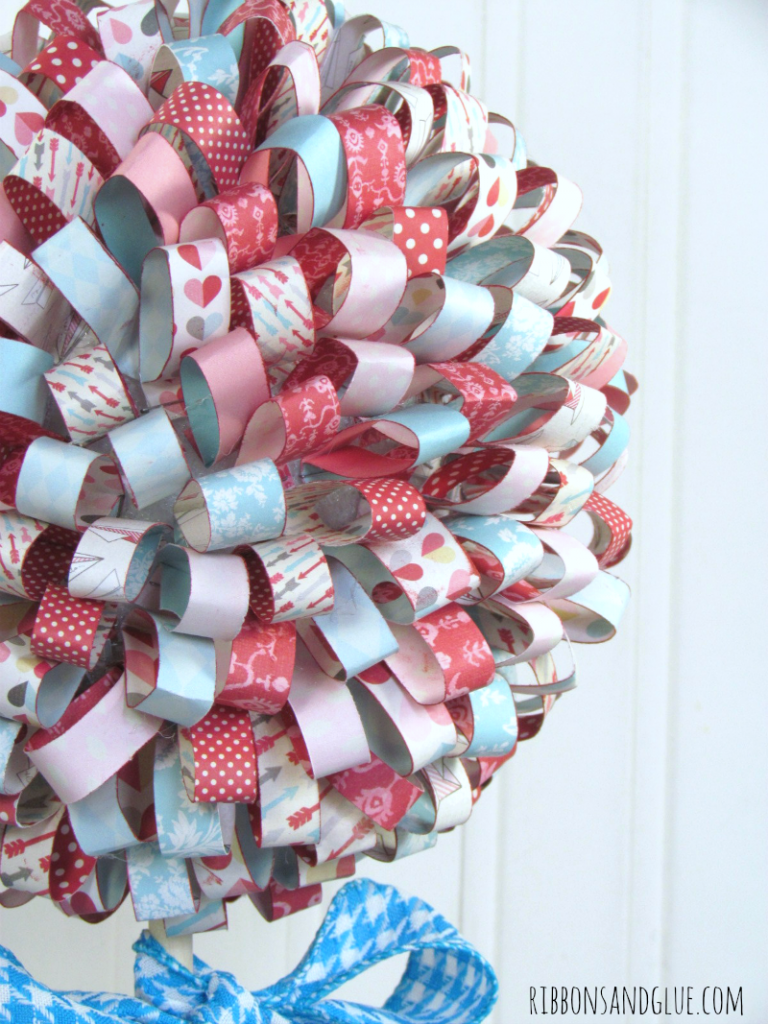 Valentine's Paper Ribbon Topiary. Beautiful DIY paper ribbons makes such a gorgeous Valentine's home decor statement.