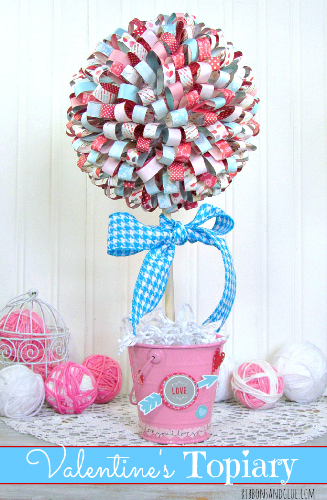 Valentine's Paper Ribbon Topiary. Tutorial on how to make paper ribbons out of scrapbooking paper, hot glue on to foam ball to make beautiful tipiary.