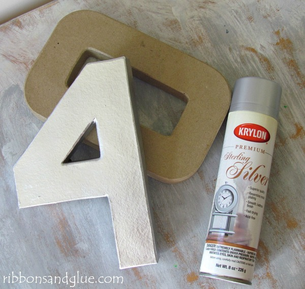 Spray Painted Paper Mache numbers with Krylon Sterling Silver