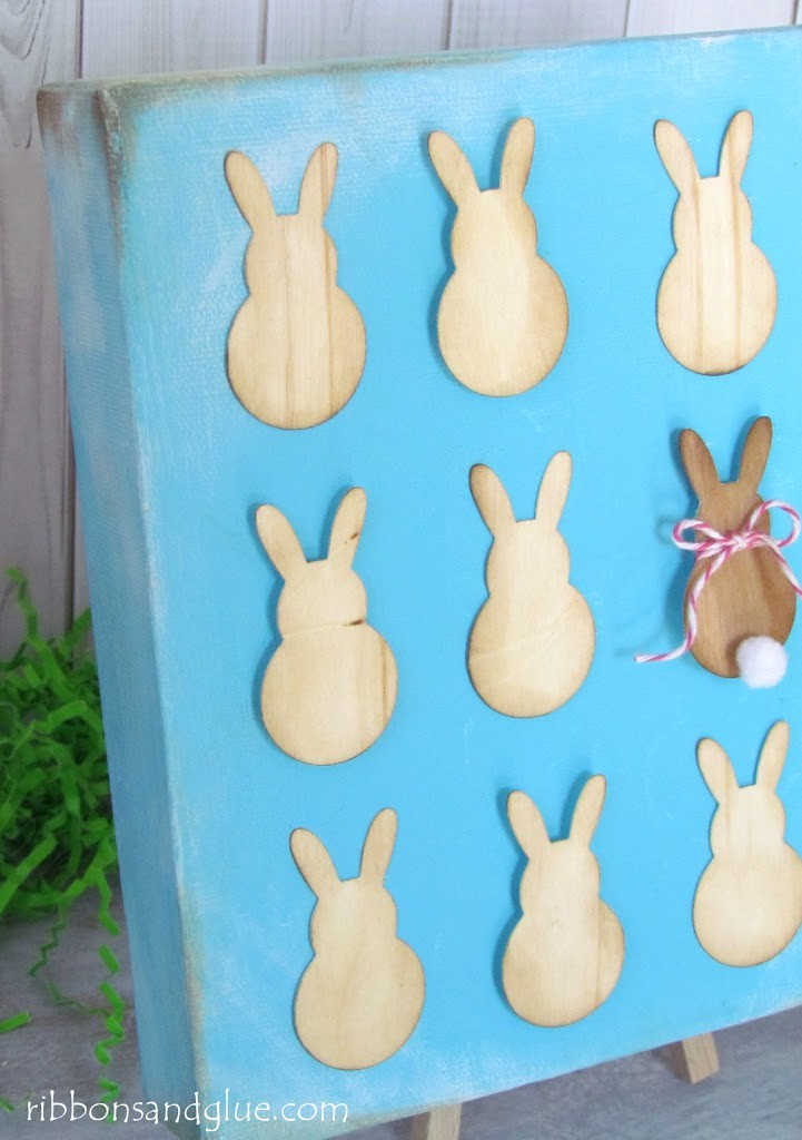Bunny Art Canvas made with wood veneer bunnies cut out with Silhouette.  Cute Easter Craft idea!