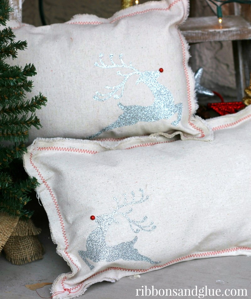 Inexpensive Christmas Pillows made out of Drop Cloth and heat transfer vinyl cut with Silhouette