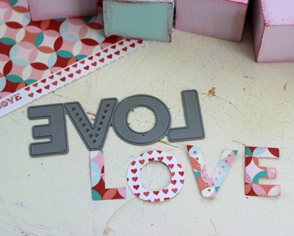 LOVE metal die cut makes the perfect size letters to adhere on to blocks.