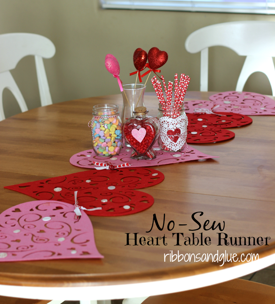 No-Sew Valentine's Heart Table Runner. Dollar Store felt heart placemats tied together with ribbon. Easy Valentine's Decor Craft.