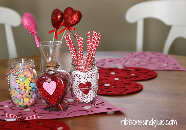 Valentine's Table Centerpiece. Paper straws, candy in mason jars all from the Dollar Store.