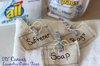 Canvas Laundry Room Tags made from drop cloth. Add machine stitching around tag and label with Sharpie. Clip on basket with cute clothespins.