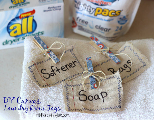 DIY Drop Cloth Laundry Room Tags  made from drop cloths scraps. Add machine stitching around tag and label with Sharpie. Clip on basket with cute clothespins. #FreeToBe