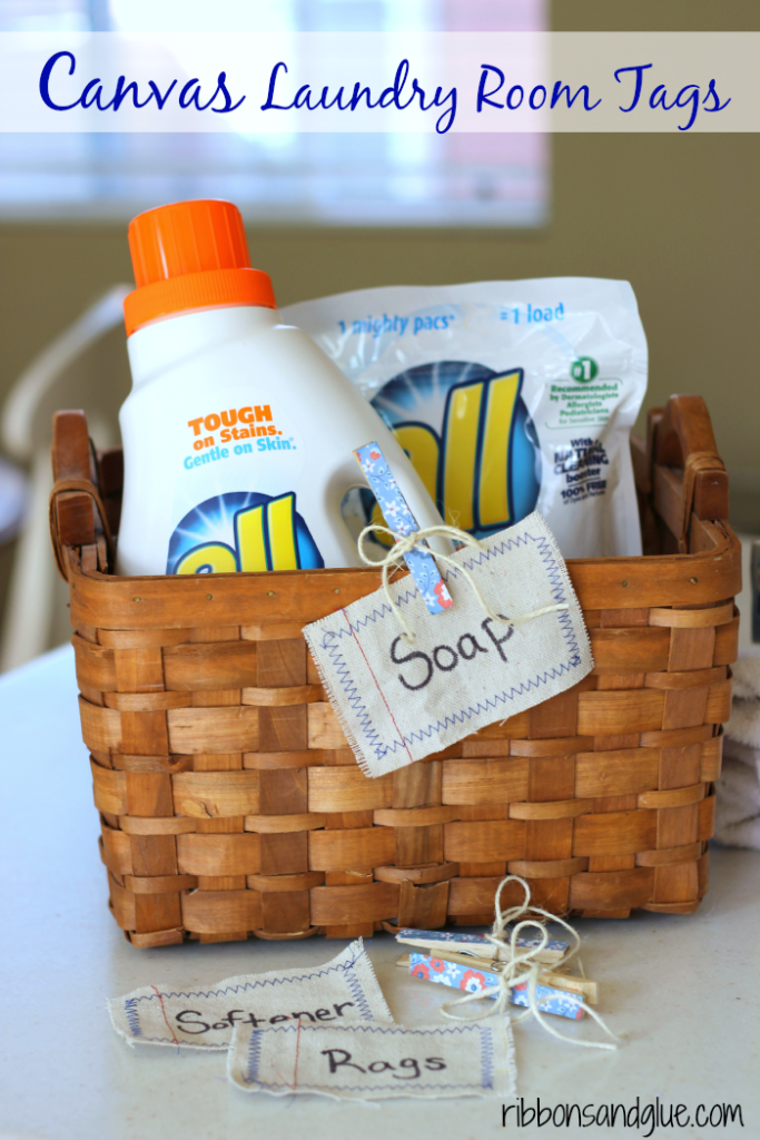 DIY Drop Cloth Laundry Room Tags made out of scraps of drop cloth with machine stitching around tag. Just label with Sharpie and clip on to a basket with cute decoupaged clothespins. #FreeToBe