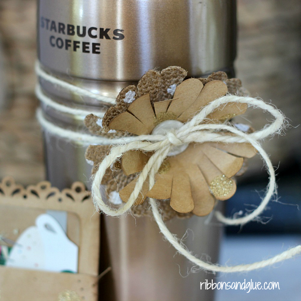Make Mom this DIY Gift for the Coffee Lover in her. Simple paper flower wrapped on a coffee mug with coordinating gift card holder. Easy Mother's Day Gift Idea.