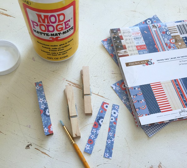Use Mod Podge to decoupage patterned paper on to clothepins
