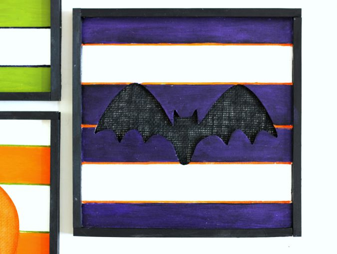 DIY Halloween Gallery Wall Art Bat. Painted wood wall plaque with a burlap backing.