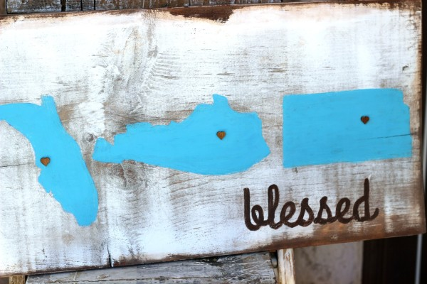DIY Rustic Blessed Sign made from a painted and stained wood board that is personalized with States lived in and wood veneer hearts