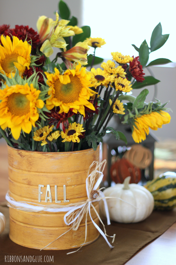 DIY Rustic Flower Vase made out of a coffee can and paint!. Simple Fall DIY project that provides a great way to add color.