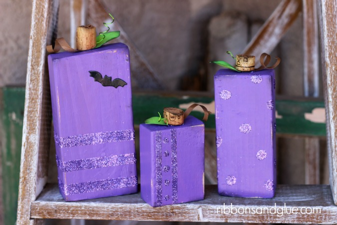 Purple Glitter Pumpkins made from blocks of wood, paint and glitter. So cute and easy!
