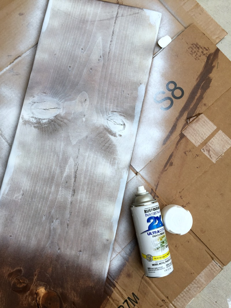 Spraying painting a wood board to make a Rustic, Chippy Wood Sign