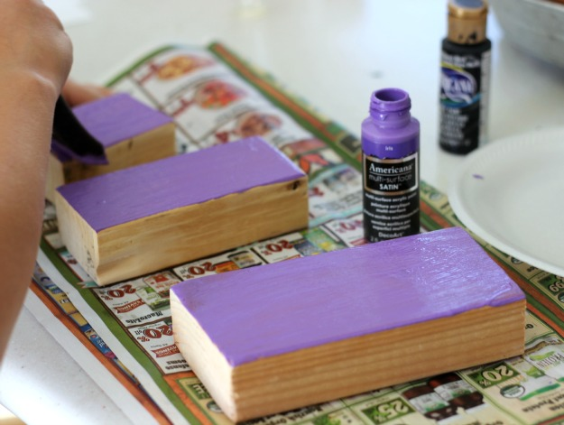 Painted Purple wood blocks to make Halloween pumpkins