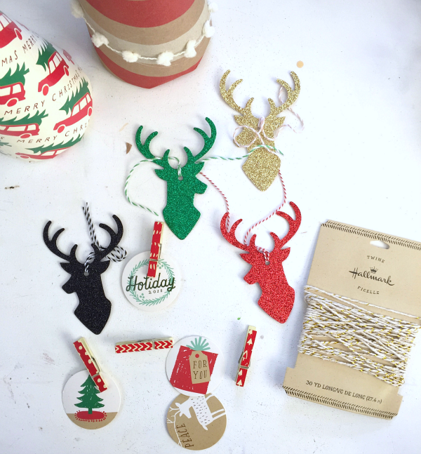 Glitter Deer heads add a beautiful touch to Holiday Decor and gift wrapoing