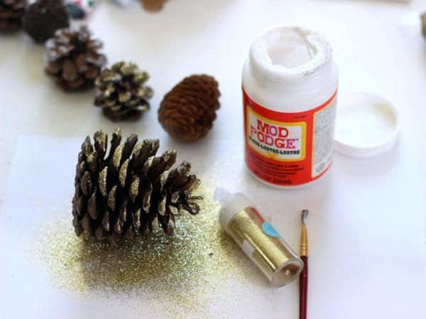 Brush on Mod Podge then sprinkle glitter over to make pretty pine cones for the Holidays