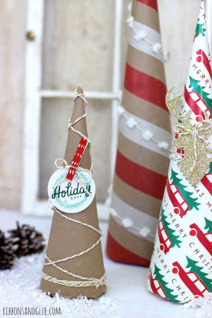 Christmas Wrapping Paper Trees. Such a pretty and expensive way to add unique projects in to your Holiday Decor.
