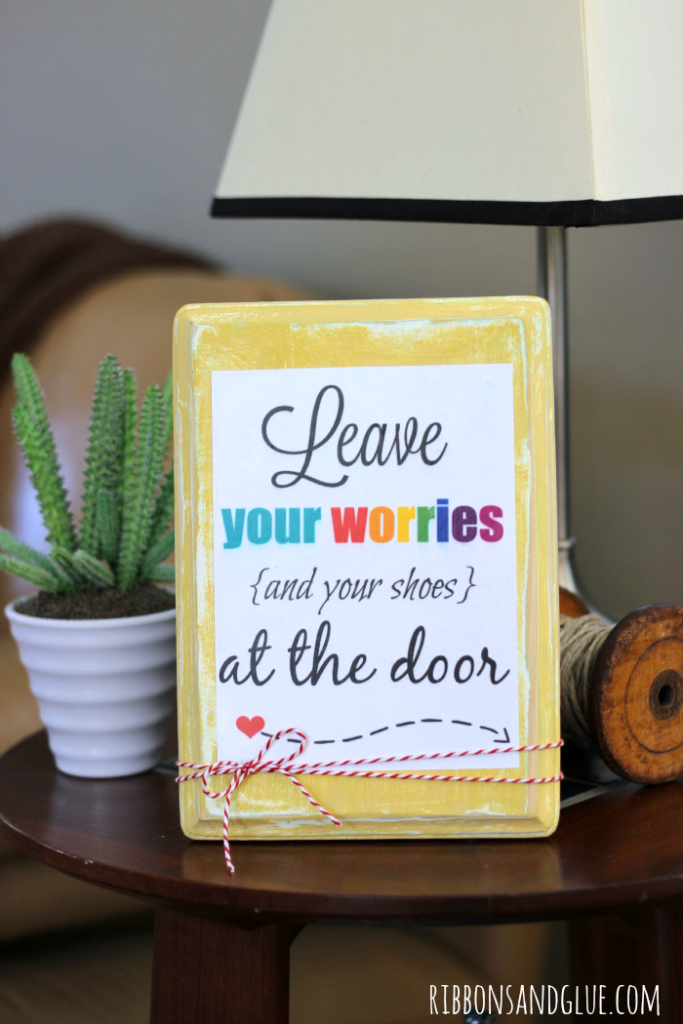 Create a DIY sign to display this fun printable to remind your guests the No Shoes rule on the carpet