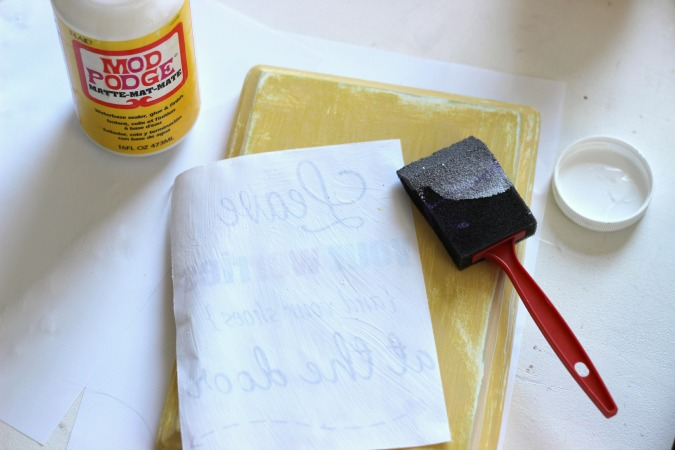 Use Mod Podge to adhere paper on to wood