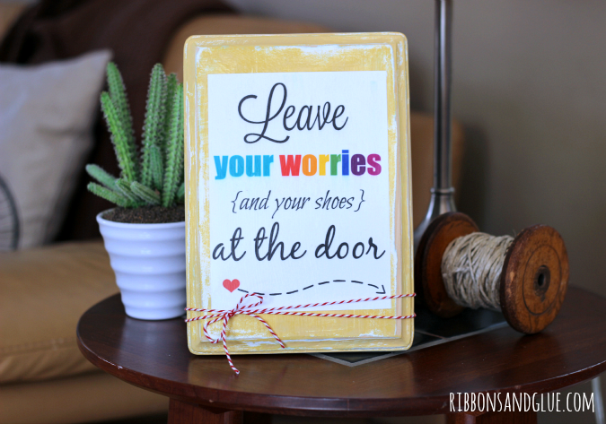 Create a DIY sign to display to your guests the no shoes on the carpet rule