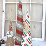 Easy tutorial on how to make Wrappin Paper Trees. Wraping paper is such a in expeinsive way to add unqiie projects in to you home decor.